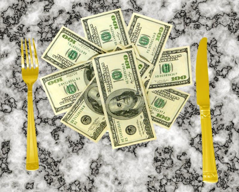 Dinero con el cuchillo y la fork fotografía de archivo libre de regalías