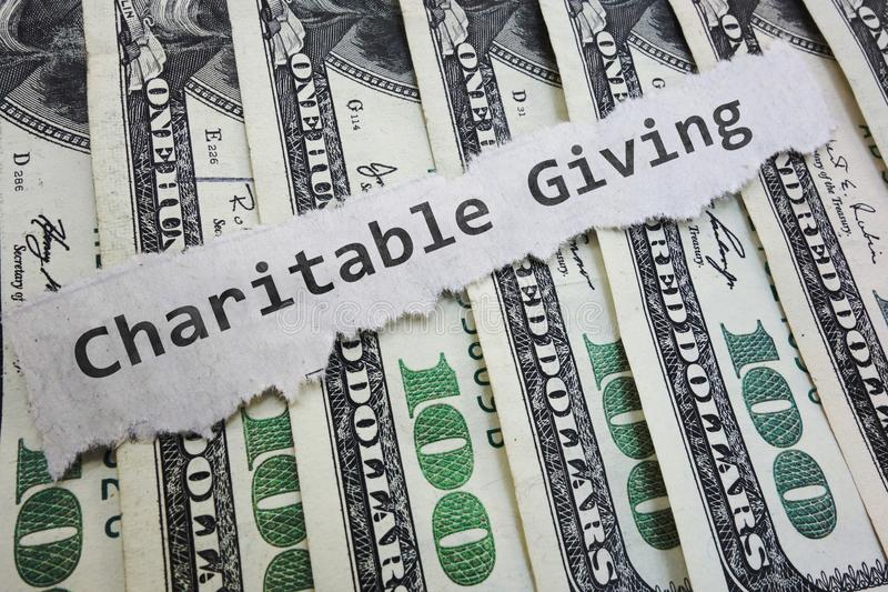 Dinero de la contribución caritativa fotografía de archivo
