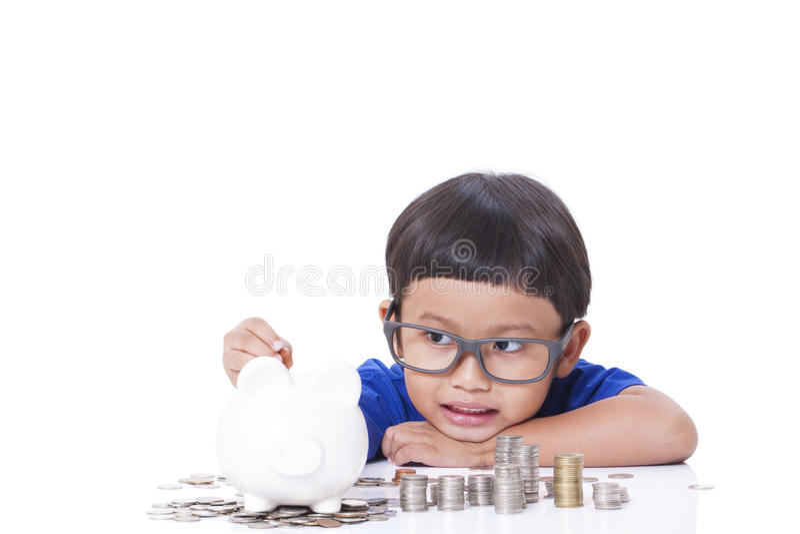 Dinero del ahorro del muchacho fotografía de archivo
