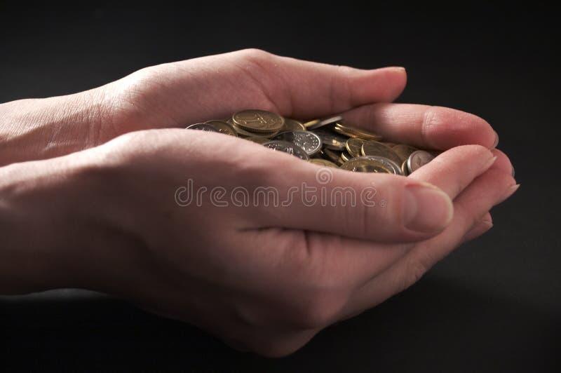 Dinero del puñado fotos de archivo