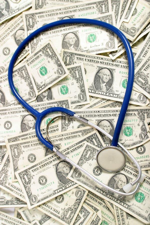 Dinero, dinero, dinero en campo médico fotos de archivo