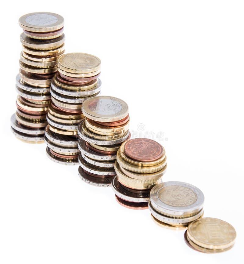 Dinero empilado aislado en blanco imagen de archivo