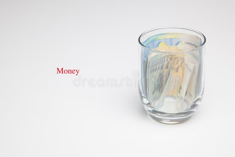 Dinero en billetes y monedas euro fotos de archivo