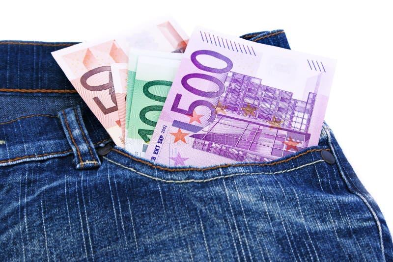 Dinero en bolsillo de los pantalones vaqueros foto de archivo libre de regalías
