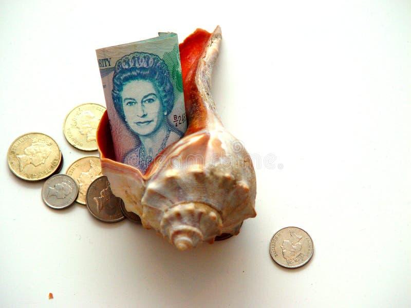 Dinero en circulación de Bermudas envuelto en el dinero en circulación de Bermudas fotografía de archivo