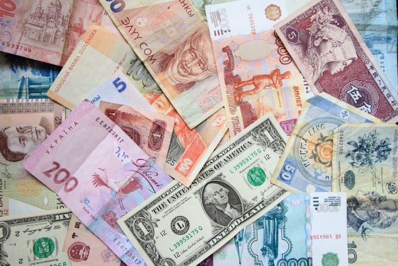 Dinero en circulación de diversos países imágenes de archivo libres de regalías