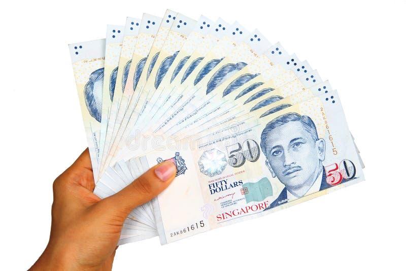 Dinero en circulación de Singapur. foto de archivo