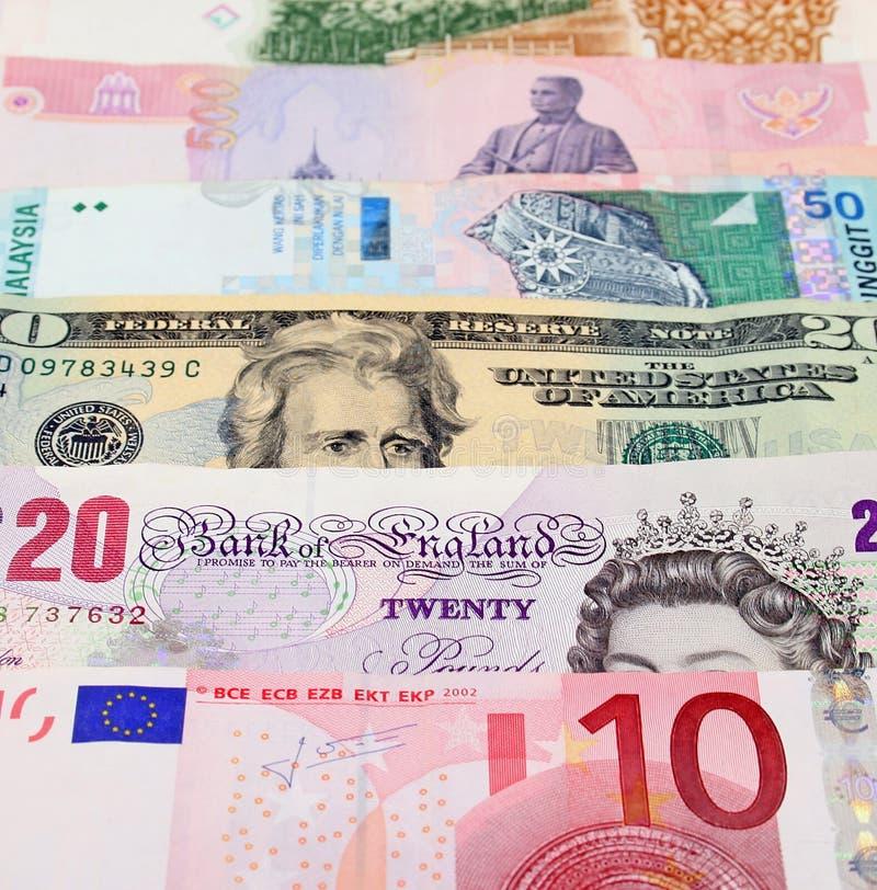 Dinero en circulación global foto de archivo libre de regalías
