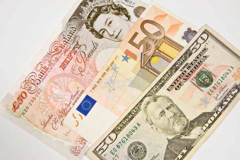 Dinero en circulación internacional imagenes de archivo