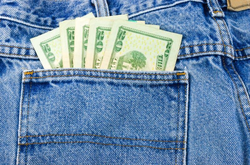 Dinero en el bolsillo de Jean foto de archivo libre de regalías