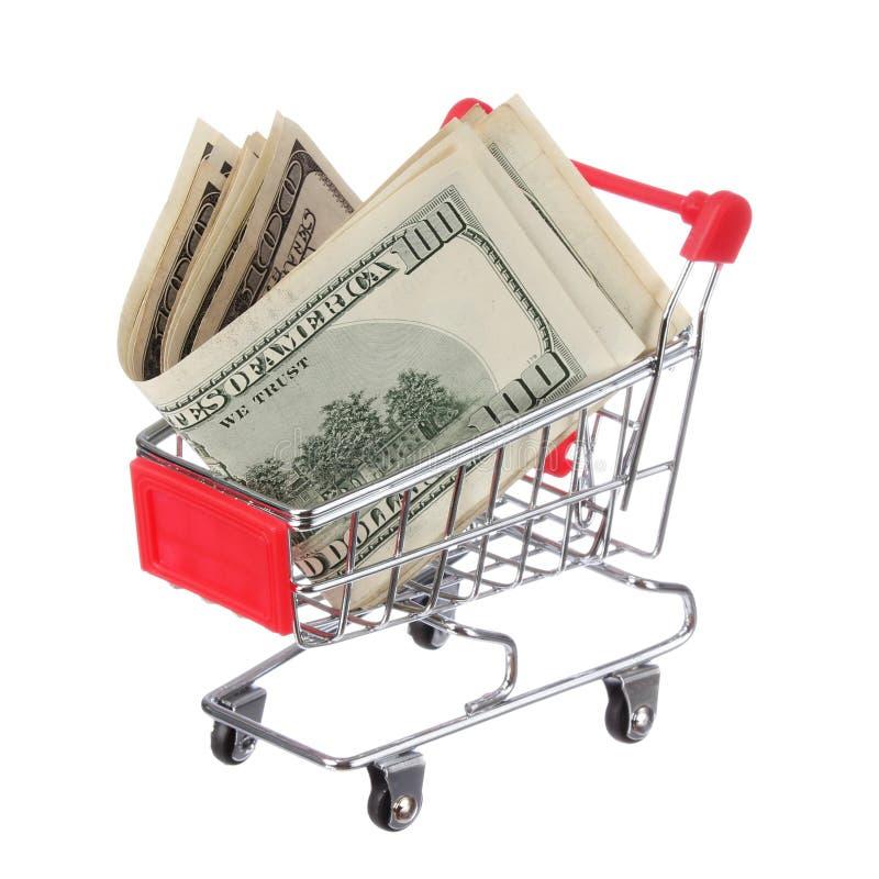 Dinero en el carro de la compra aislado en blanco. Billetes de dólar en carretilla fotografía de archivo libre de regalías