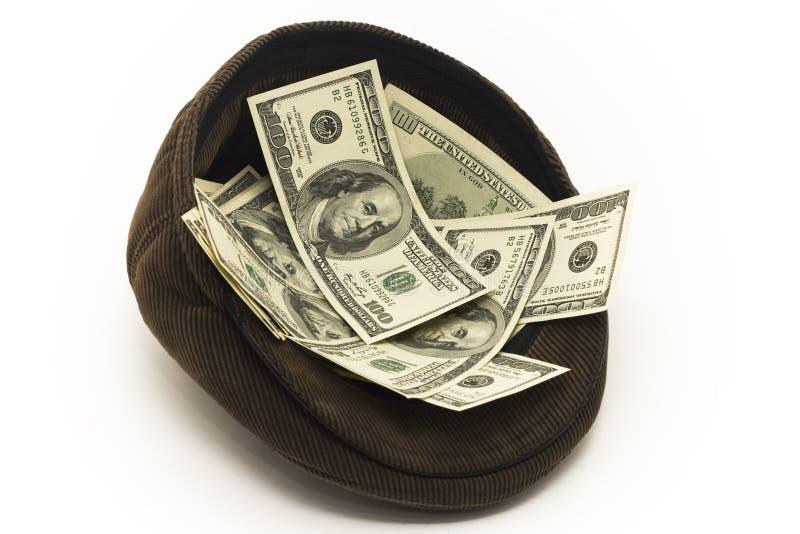 Dinero en el casquillo imagenes de archivo