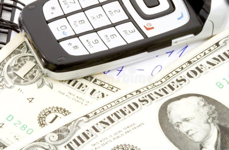 Dinero en llamada imagen de archivo libre de regalías