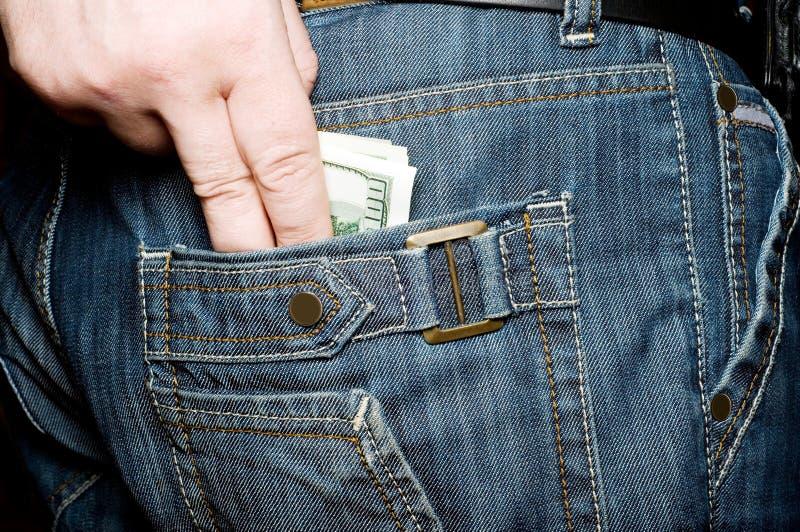 Dinero en su bolsillo fotografía de archivo