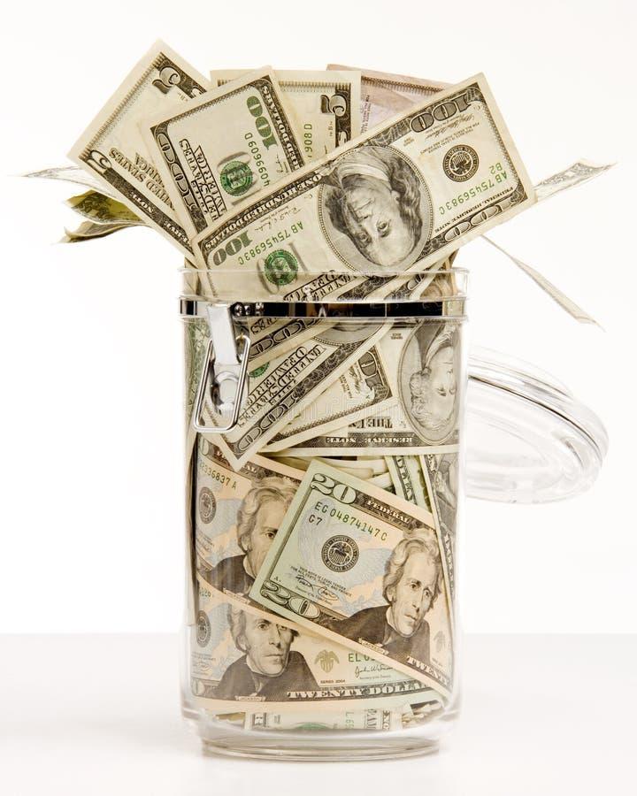 Dinero en tarro imagen de archivo libre de regalías