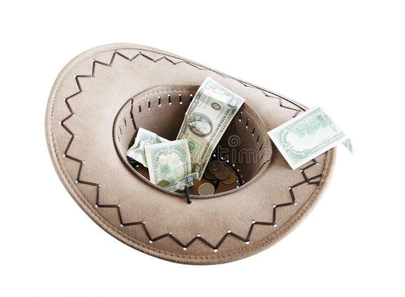 Dinero en un sombrero de vaquero fotos de archivo