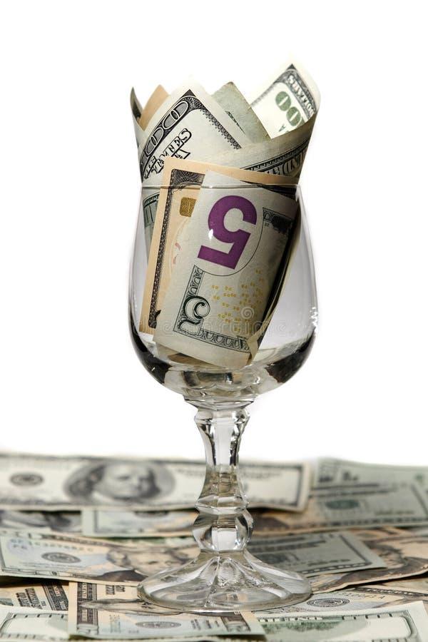 Dinero en un vidrio foto de archivo