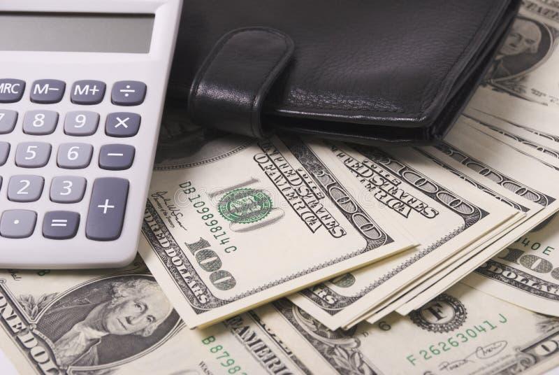 Dinero, monedero y calculadora fotografía de archivo libre de regalías