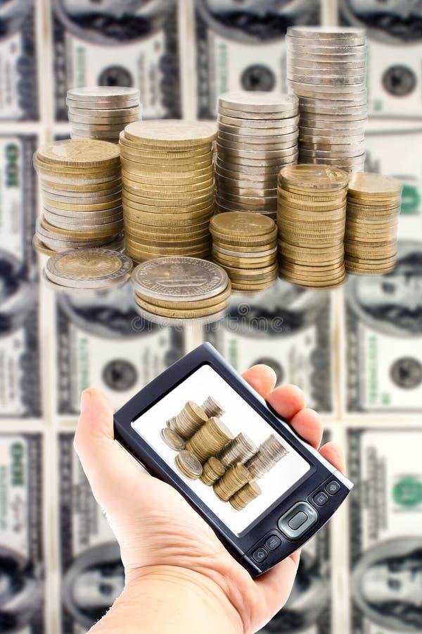 Dinero virtual en un handheld fotos de archivo libres de regalías