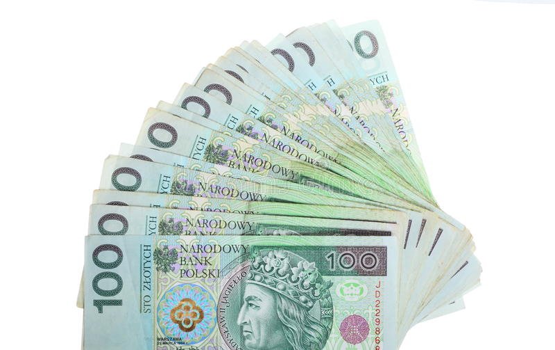 Dinero y ahorros. Pila de billetes de banco del zloty del pulimento 100's foto de archivo