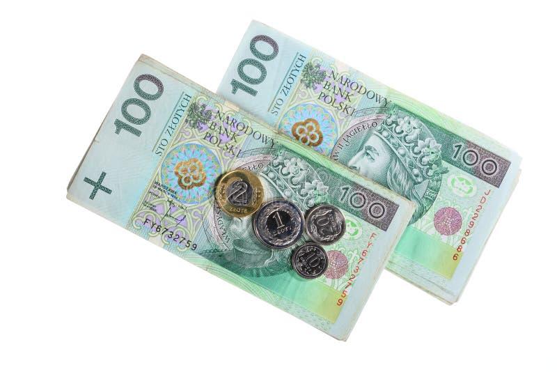Dinero y ahorros. Pila de billetes de banco del zloty del pulimento 100's fotografía de archivo