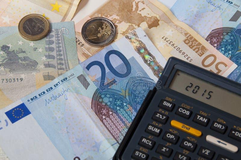 Dinero y calculadora 2015 imagen de archivo