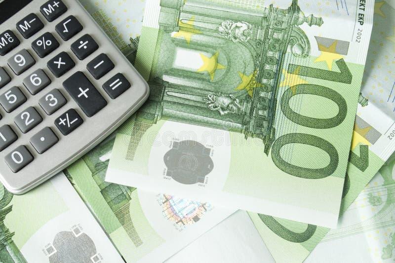 Dinero y calculadora euro fotografía de archivo