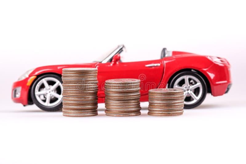 Dinero y coche fotos de archivo