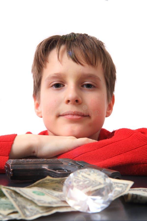 Dinero y diamante del muchacho fotos de archivo libres de regalías