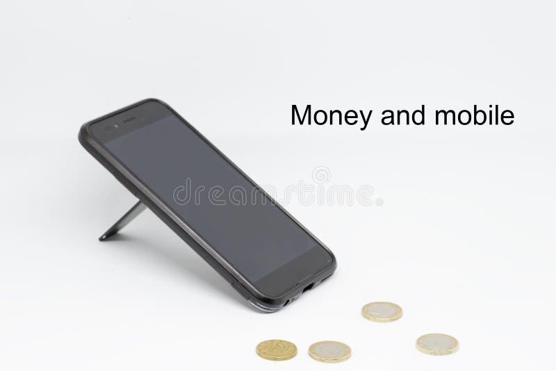 Dinero y móvil imagenes de archivo