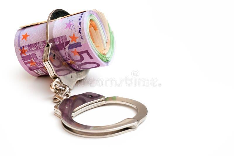 Dinero y manillas foto de archivo