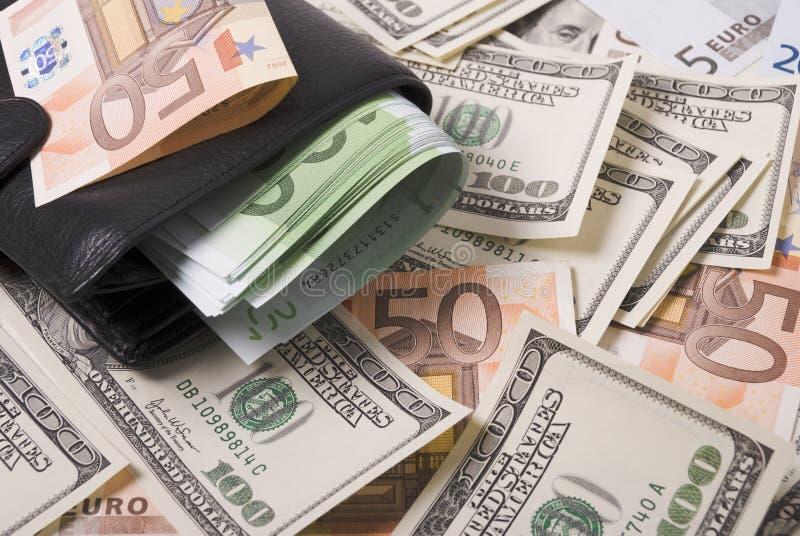Dinero y monedero imágenes de archivo libres de regalías