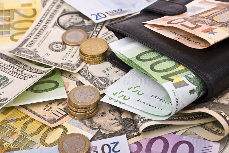 Dinero y monedero foto de archivo libre de regalías