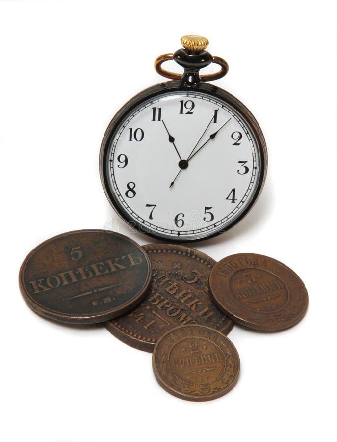 Dinero y reloj foto de archivo libre de regalías