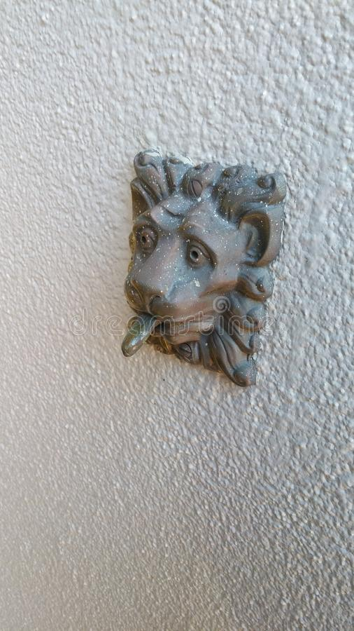 Ding. Lion doorbell chime royalty free stock photo