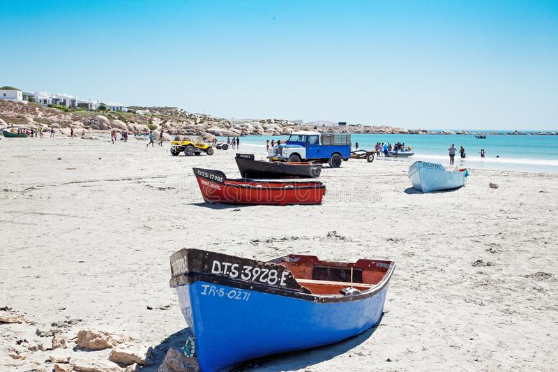 Dinghies on beach stock images
