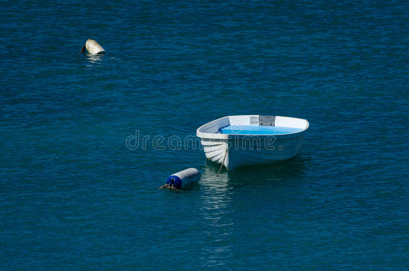 Dinghy. In blue ocean royalty free stock photography