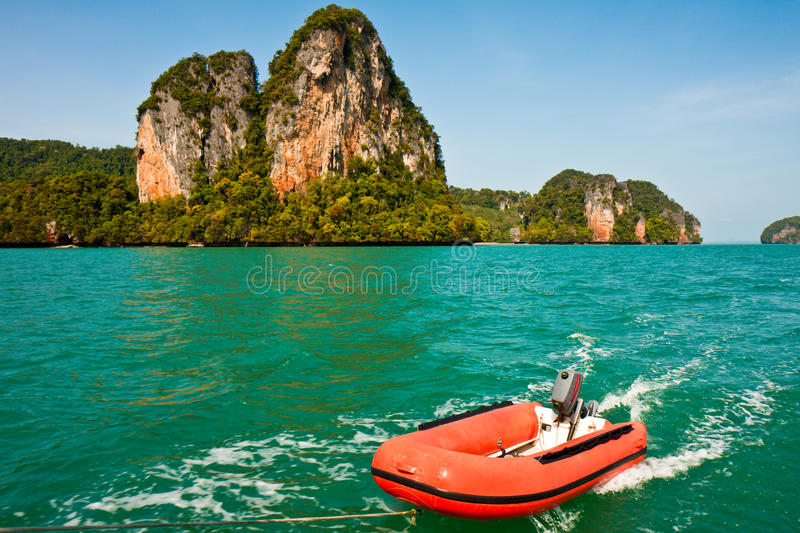 Dinghy in the Ocean. Dinghy dragged behind a sailboat in Ao Phang Nga, Thailand stock photos