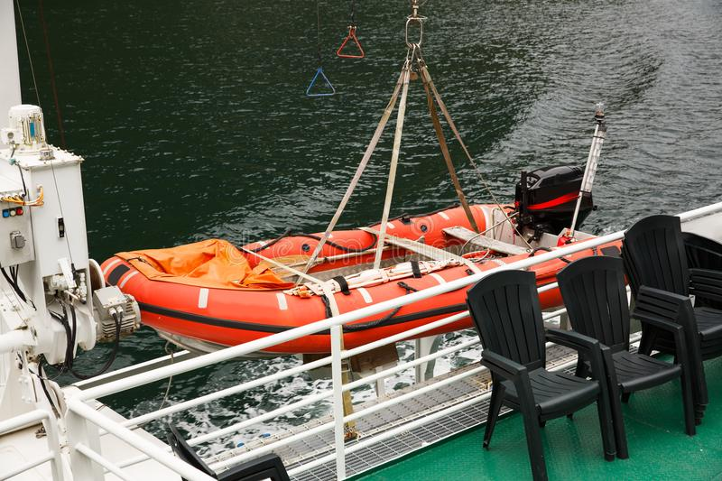 Dinghy. Rubber dinghy with powerful outboard engine on the ship stock photo