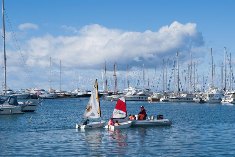Dinghy Sailing Lessons Alimos Greece. Dinghy Sailing Lessons with instructor and kids in Alimos, Greece harbor royalty free stock photography