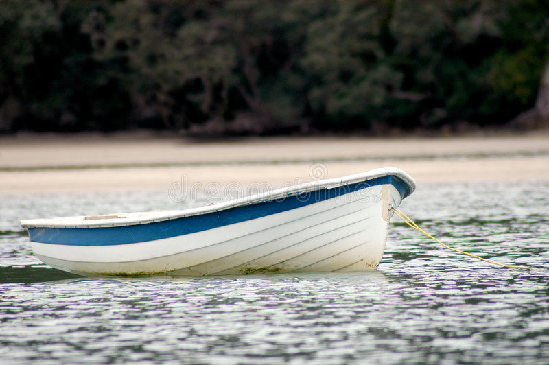 Dinghy on water. Dinghy out on the water with no people in it stock images