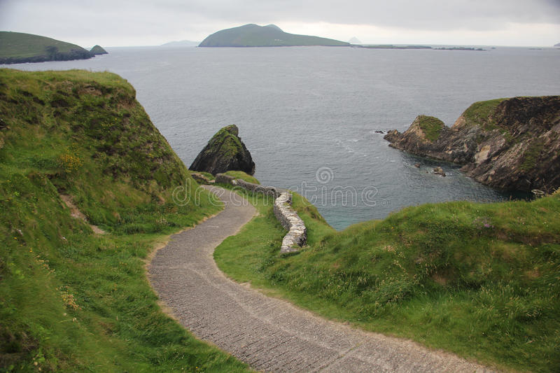 Dingle Peninsula. The Dingle Peninsula is the northernmost of the major peninsulas in County Kerry. It ends beyond the town of Dingle at Dunmore Head stock images