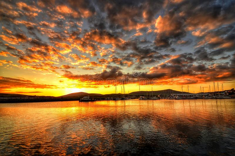Dingle Sunset. Sun setting over Dingle harbour county Kerry Ireland royalty free stock images