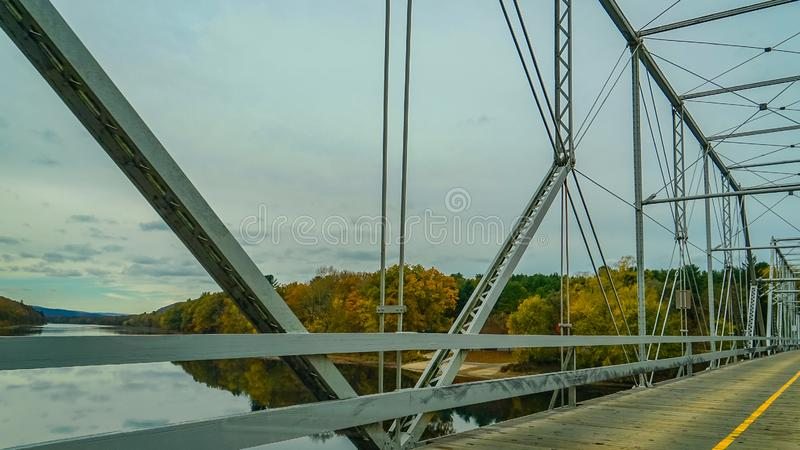 Dingmans Ferry Bridge across the Delaware River in the Poconos Mountains, connecting the states of Pennsylvania and New Jersey, US stock photography