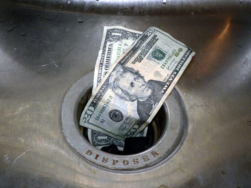 Dinheiro abaixo do dreno 2 fotos de stock