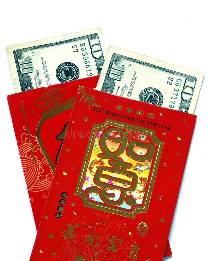 Dinheiro afortunado (bolsos vermelhos) fotografia de stock royalty free