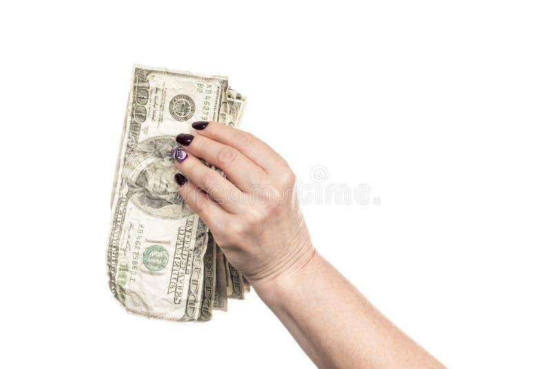 Dinheiro amarrotado na mão fêmea imagens de stock