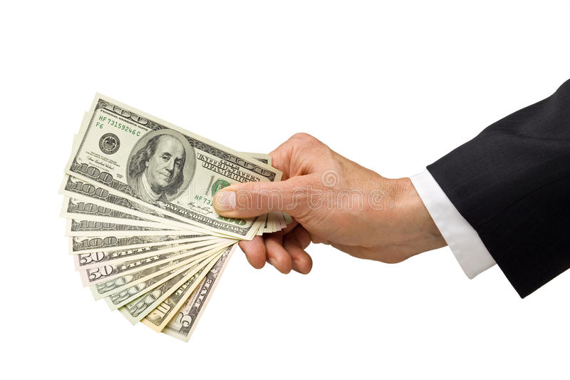 Dinheiro americano à disposicão fotografia de stock