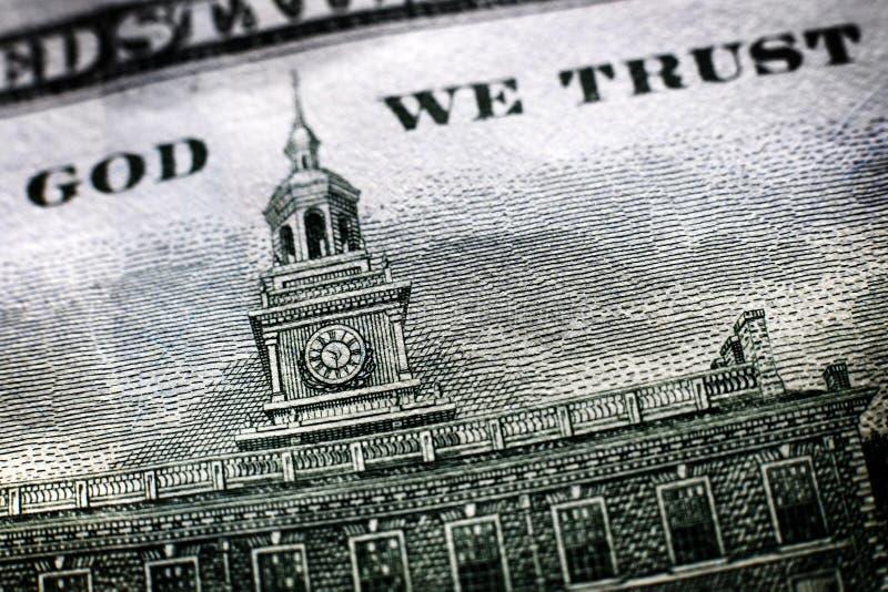 Dinheiro americano no deus nós confiança imagens de stock