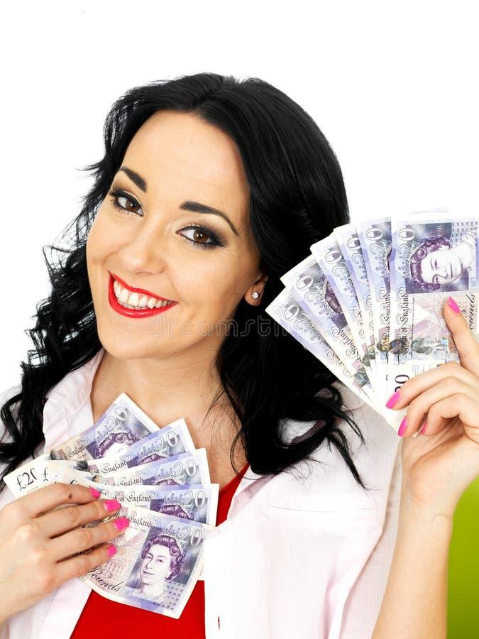 Dinheiro bonito feliz de Rich Young Hispanic Woman Holding fotografia de stock royalty free